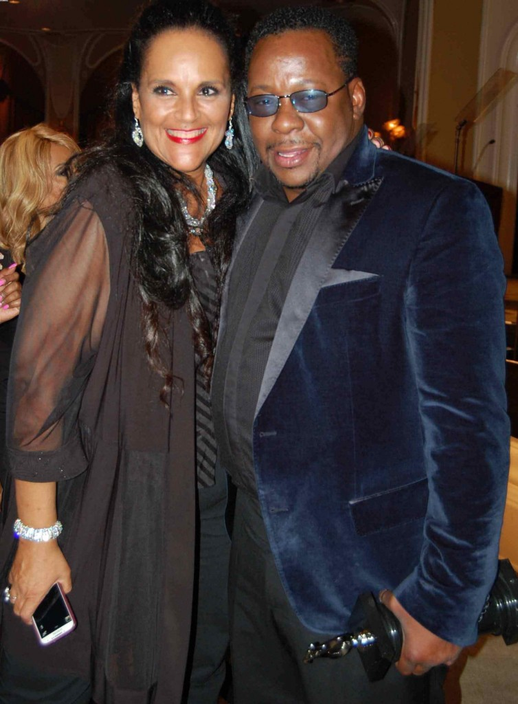 Jayne Kennedy and Bobby Brown compliment each other in black chiffon and blue velvet.