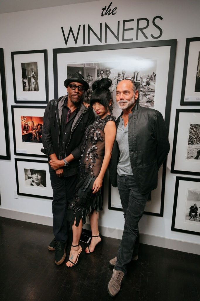 Cover photo- Cuba Gooding Jr. takes time to pose with his date at the Sunset Marquis. Seen in the background is Ross Kolde, Scoop LA journalist. Inside photo- Arsenio Hall(L) with Actress Bai Ling (C) and Artist Tim White. Photo by Zach Whitford.